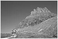 Two backpackers descending on trail near Logan Pass. Glacier National Park, Montana, USA. (black and white)