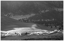 Storm light illuminates portions of the dune field. Great Sand Dunes National Park and Preserve ( black and white)
