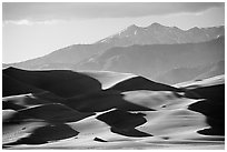 Distant view of dunes and Sangre de Christo mountains in late afternoon. Great Sand Dunes National Park and Preserve ( black and white)