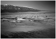 Sand dunes with patches of snow seen from above. Great Sand Dunes National Park and Preserve ( black and white)