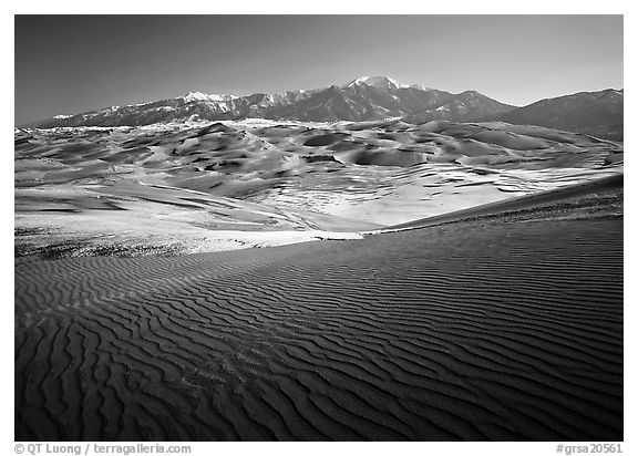Rippled dunes and Sangre de Christo mountains in winter. Great Sand Dunes National Park, Colorado, USA.