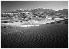 Rippled dunes and Sangre de Christo mountains in winter. Great Sand Dunes National Park, Colorado, USA. (black and white)