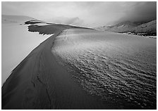 Zig-zag pattern of sand amongst Snow on the dunes. Great Sand Dunes National Park and Preserve ( black and white)