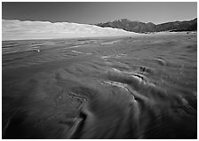 Medano creek with shifting sands, dunes and Sangre de Christo mountains. Great Sand Dunes National Park and Preserve ( black and white)