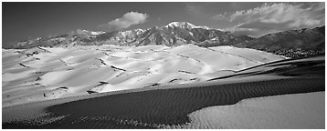 Landscape of snowy dunes and mountains. Great Sand Dunes National Park and Preserve (Panoramic black and white)