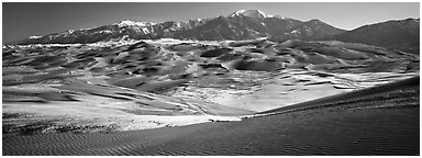 Landscape of sand dunes and mountains in winter. Great Sand Dunes National Park and Preserve (Panoramic black and white)