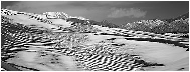 Melting snow on sand dunes. Great Sand Dunes National Park and Preserve (Panoramic black and white)