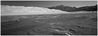 Wide shallow creek at the base of dune field. Great Sand Dunes National Park and Preserve (Panoramic black and white)