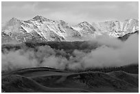 Snowy Sangre de Cristo Mountains and clouds above dune field. Great Sand Dunes National Park and Preserve ( black and white)