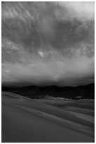 Dunes, moonlit clouds, and stars. Great Sand Dunes National Park and Preserve ( black and white)
