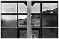 Grasslands and mountains, visitor center window reflexion. Great Sand Dunes National Park and Preserve ( black and white)