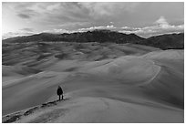 Hiker climbing high dune. Great Sand Dunes National Park and Preserve ( black and white)
