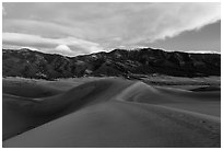 Dunes and Mount Zwischen at dusk. Great Sand Dunes National Park and Preserve ( black and white)