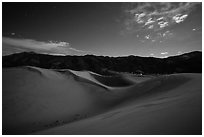 Dunes and mountains at night. Great Sand Dunes National Park and Preserve ( black and white)