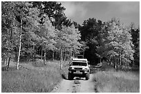 4WD vehicle on Medano primitive road in autumn. Great Sand Dunes National Park and Preserve ( black and white)