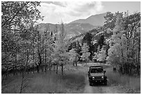 Jeep on Medano primitive road near Medano Pass in autumn. Great Sand Dunes National Park and Preserve ( black and white)