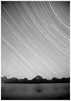 Star trails on Teton range above Jackson lake, dusk. Grand Teton National Park ( black and white)