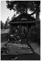 Outdoorsmen camping out in front of Jenny Lake Ranger Station for permits. Grand Teton National Park ( black and white)