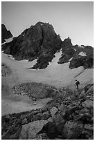 Mountaineer stands below Middle Teton and glacier. Grand Teton National Park ( black and white)