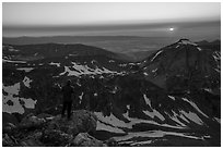 Mountaineer watches sunset from Lower Saddle. Grand Teton National Park ( black and white)