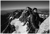 Mountaineer looks up while climbing Grand Teton. Grand Teton National Park ( black and white)