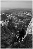 Climber rappels down Sargeant's Chimney on Grand Teton. Grand Teton National Park ( black and white)