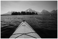 Kayak pointing at island in Colter Bay. Grand Teton National Park ( black and white)