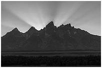 Crepuscular rays behind the Tetons. Grand Teton National Park ( black and white)