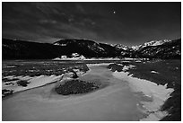 Frozen stream, Moraine Park at night. Rocky Mountain National Park, Colorado, USA. (black and white)