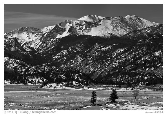 Thawing meadow and snowy peaks, late winter. Rocky Mountain National Park, Colorado, USA.