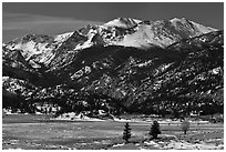 Thawing meadow and snowy peaks, late winter. Rocky Mountain National Park, Colorado, USA. (black and white)