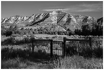 Fence around ranch house site, Elkhorn Ranch Unit. Theodore Roosevelt National Park, North Dakota, USA. (black and white)