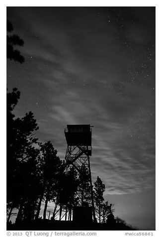 Rankin Ridge tower at dusk and starry sky. Wind Cave National Park, South Dakota, USA.