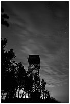 Rankin Ridge tower at dusk and starry sky. Wind Cave National Park, South Dakota, USA. (black and white)