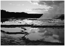 Great Fountain Geyser with residual steam at sunset. Yellowstone National Park, Wyoming, USA. (black and white)