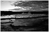 Great Fountain geyser and colorful clouds at sunset. Yellowstone National Park, Wyoming, USA. (black and white)