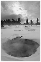 Thermal pool and dark clouds, winter. Yellowstone National Park ( black and white)