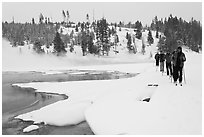 Cross country skiers pass Chromatic Spring. Yellowstone National Park, Wyoming, USA. (black and white)