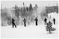 Skiers and thermal steam. Yellowstone National Park, Wyoming, USA. (black and white)