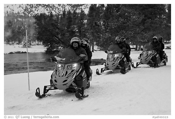 Snowmobile riders. Yellowstone National Park, Wyoming, USA.