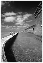 Tourists walking on seawall. Dry Tortugas National Park ( black and white)