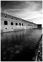 Fort Jefferson moat and thick brick walls. Dry Tortugas National Park ( black and white)