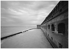 Fort Jefferson wall overlooking the ocean, cloudy weather. Dry Tortugas  National Park ( black and white)