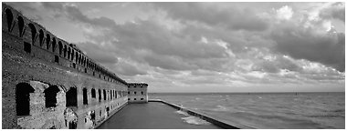 Ruined masonery wall overlooking Carribean waters. Dry Tortugas National Park (Panoramic black and white)