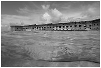 Split view of Fort Jefferson and water with fish. Dry Tortugas National Park ( black and white)