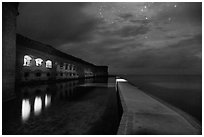 Fort Jefferson, moat, and ocean at night. Dry Tortugas National Park ( black and white)