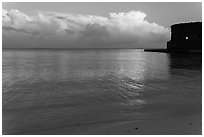 Tropical clouds, beach, and fort at sunrise. Dry Tortugas National Park ( black and white)