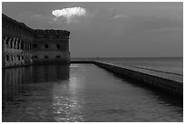 Moat, fort, bright cloud at dawn. Dry Tortugas National Park ( black and white)