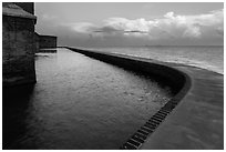 Seawall at sunrise. Dry Tortugas National Park ( black and white)