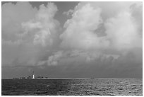 Loggerhead key and lighthouse under tropical clouds. Dry Tortugas National Park, Florida, USA. (black and white)
